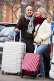 Mature couple with luggage at street Royalty Free Stock Photo