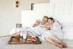 Mature couple in a luxurious hotel room Royalty Free Stock Image