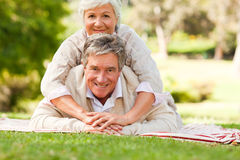Mature couple lying down Royalty Free Stock Photography