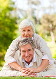 Mature couple lying down in the park Royalty Free Stock Photo