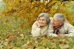 Mature couple lying Stock Photos
