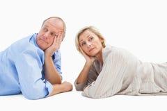 Mature couple lying and thinking Stock Photo