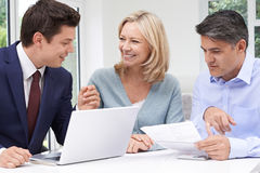 Mature Couple Meeting With Financial Advisor At Home royalty free stock photo
