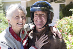 Mature couple in motorcycle gear Stock Photography