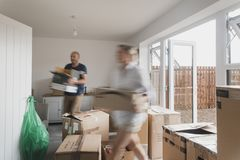 Mature Couple Moving In Stock Photo
