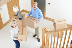 Mature Couple Moving In To New Home Stock Photos