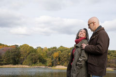 Mature couple near a lake Stock Images