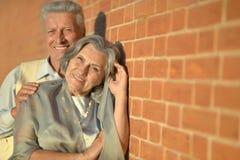 Mature couple near wall Royalty Free Stock Photography