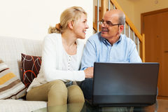 Mature couple with notebook royalty free stock photography