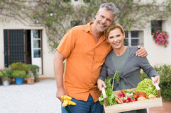 Mature Couple With Organic Vegetables Royalty Free Stock Photo