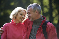 A mature couple outdoors, looking affectionately at each other Royalty Free Stock Image