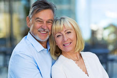 Mature Couple Outdoors. Loving Senior Couple Outdoors Smiling Stock Photography