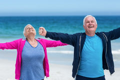 Mature couple outstretching their arms together Stock Image