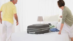 Mature couple packing Royalty Free Stock Photography