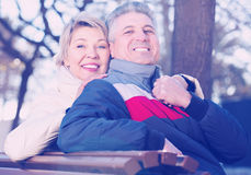 Mature couple on park bench Royalty Free Stock Photo