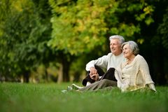 Mature couple in park Royalty Free Stock Image