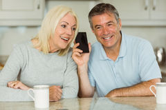 Mature couple on a phone call together Royalty Free Stock Images