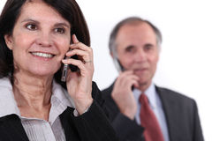 Mature couple on the phone Royalty Free Stock Image