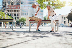 Mature couple photographing each other Stock Photo