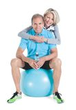 Mature couple on pilates ball stock images