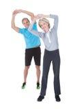 Mature couple on pilates ball Royalty Free Stock Photos