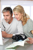 Mature couple planning a travel Royalty Free Stock Photo