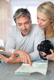 Mature couple planning travel Royalty Free Stock Photo
