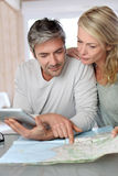 Mature couple planning a travel Royalty Free Stock Images