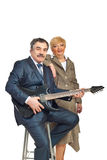 Mature couple playing guitar Royalty Free Stock Photos