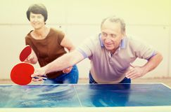 Mature couple playing ping pong Royalty Free Stock Images
