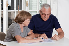 Mature Couple playing Scrabble Game. Portrait of mature couple playing scrabble game Stock Photos
