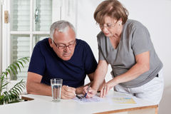 Mature Couple playing Scrabble Game Stock Images