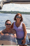 Mature couple on a pontoon boat Stock Photography
