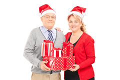 Mature couple posing with Christmas presents Royalty Free Stock Photography