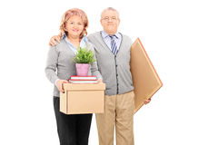Mature couple posing with moving boxes Royalty Free Stock Photo