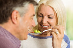Mature couple preparing meal together Stock Images