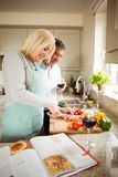 Mature couple preparing vegetables together Stock Images