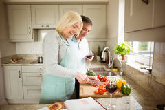 Mature couple preparing vegetables together Royalty Free Stock Image