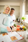 Mature couple preparing vegetables together Stock Image