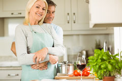 Mature couple preparing vegetarian meal together Royalty Free Stock Photo
