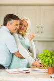 Mature couple preparing vegetarian meal together Stock Image