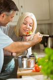 Mature couple preparing vegetarian meal together Royalty Free Stock Photography