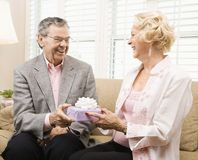 Mature couple with present. royalty free stock photography