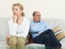 Mature couple after quarrel at home Royalty Free Stock Image