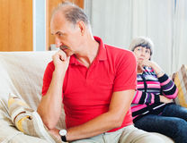 Mature couple after quarrel  at home Stock Photography