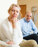 Mature couple after quarrel at home Stock Photo