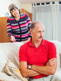 Mature couple after quarrel in living room Stock Photography