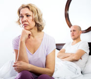 Mature couple quarrels in bed Royalty Free Stock Photos