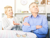 Mature couple quarrels. With each other at clarification of the family relation Royalty Free Stock Photo