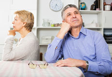 Mature couple quarrels. With each other at clarification of the family relation in home Stock Photo
